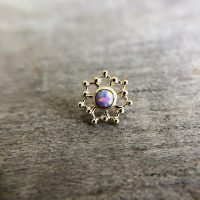 High end body piercing jewelry with opal center stone