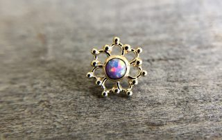 Body piercing jewelry with opal stone
